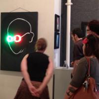 Wisdom in 3D, neon on chalkboard, 48x36 inches